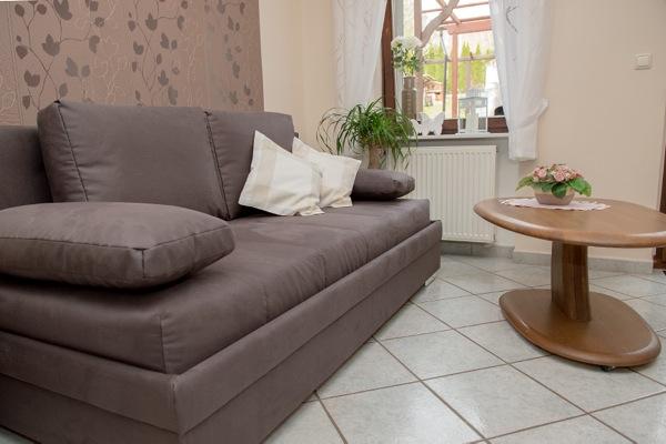 slaapbank in woonkamer vakantiewoning Ketter in Neef Moezel