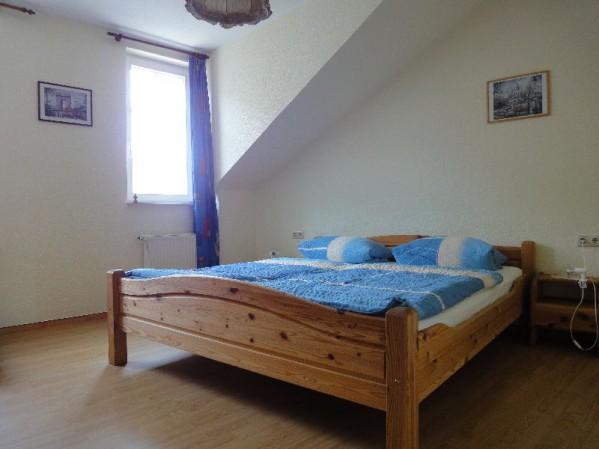 Slaapkamer vakantiewoning van Weinhaus Lenz